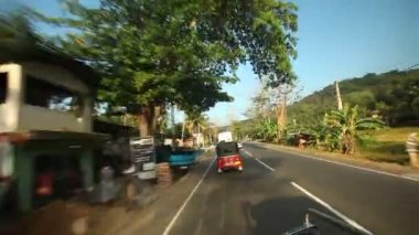 Kandy countryside overtaking a rickshaw from a moving car — Stock Video
