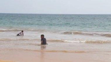 Kids are enjoying in the ocean — Stock Video
