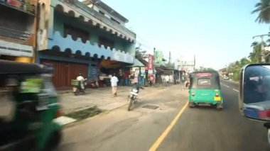 Kandy suburbs traffic from a moving car — Stock Video