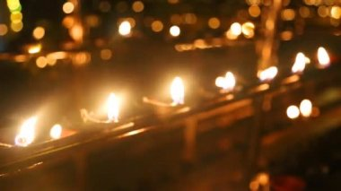 Burning candles in the Temple — Video Stock
