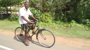 Local man riding bicycle — Stock Video