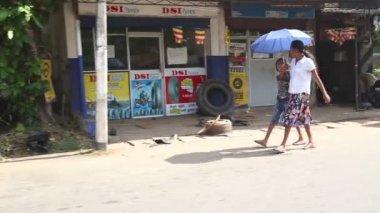 Local women walking down the street — Stock Video