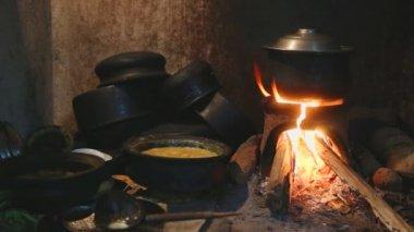 Burning fire heating  a pot — Stock Video