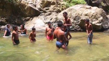 Locals enjoying the Ravana Falls — Stock Video