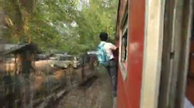 Local man traveling at the entrance of the train — Stock Video
