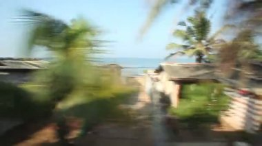 View of Colombo seaside suburbs from passing train. — Stock Video