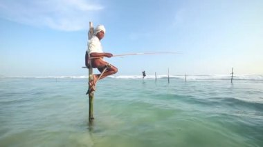 Fisherman on a fishing pole — Stock Video