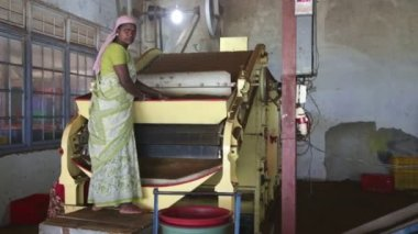 Two local women working on a machine in the tea factory — Stock Video