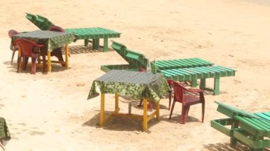 Deck chairs and tables on beach — Stockvideo