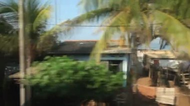 Time lapse view of Colombo seaside suburbs from passing train — Stock Video