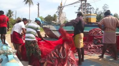 Fishermen working on a beach — Stock Video