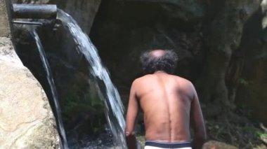 Man showering in the Ravana Falls — Stock Video