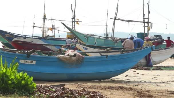 Local fishermen sorting nets on beach after long night working. — Vidéo