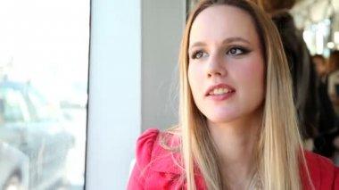 Blond woman sitting in tram — Stock video