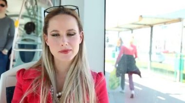 Beautiful blond woman riding tram — Stock Video