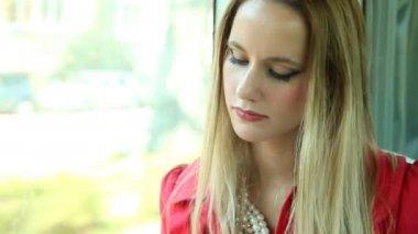 Blonde woman reading book on tram — ストックビデオ