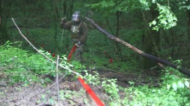 Man marking the demining area in forest — Stockvideo