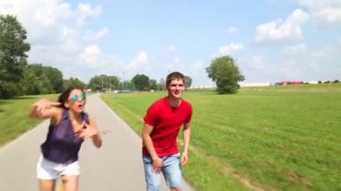 Happy young couple rollerblading — Stock Video