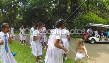 School girls posing with little caucasian girl — Stock Video