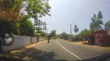 Vehicle overtaking motorcycle on the road in Sri Lanka — Stock Video