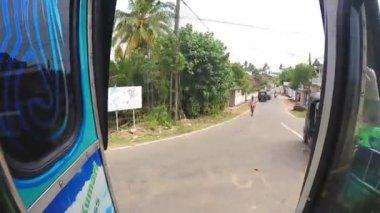 Portrait of man standing in doorway of driving bus. — Stock Video