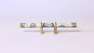 Secured dollar bill rolled into padlock — Stock Video