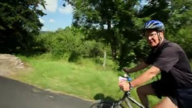 Man cycling on road in countryside — Stock Video
