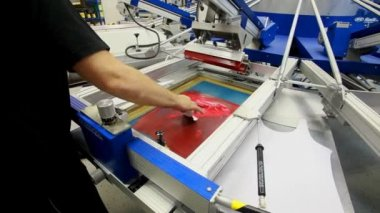 Screen printing manufacturing on t-shirts — Stock Video
