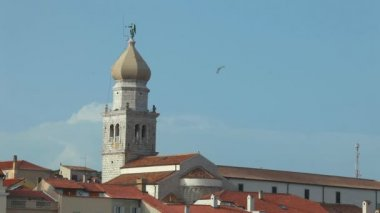 Bell tower and steeple of old town Krk in Croatia — Stock Video