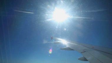 Sun shining through airplane window — Stockvideo