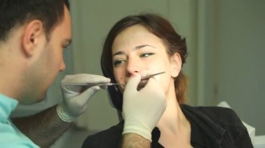 Woman at dentist's surgery — Stock Video