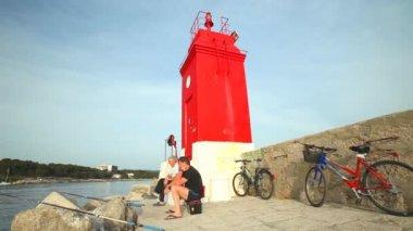 Fishermen in old town Krk harbour — Stockvideo