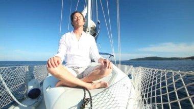 Man enjoying sailing trip on boat — Stock Video
