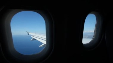 Airplane wing through plane window — Video Stock