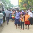 Locals standing at bus station near the Botanical Garden in Kandy. — Stock Video #58772705