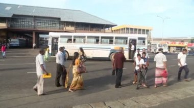 People and buses in front of central bus station — Stock Video