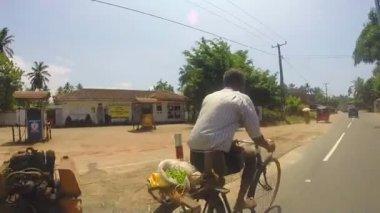 Minivan overtaking cyclist on the road — Stock Video