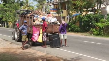 Local garbage collectors and truck — Stock Video