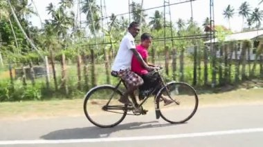 Man and woman riding bicycle — Stock Video