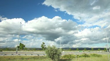 Clouds on blue sky over highway — Video Stock