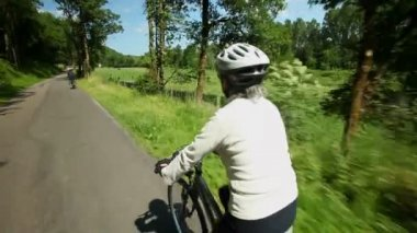 Woman cycling on road — Stock Video