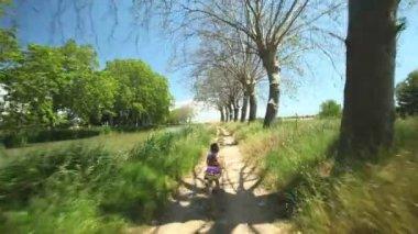 Girl running along path track — Stock Video