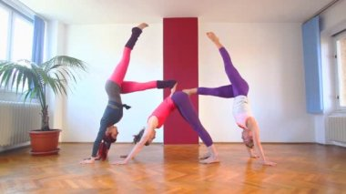 Three women doing acrobatic yoga — Stock Video