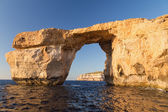 Limestone natural arch on Island of Gozo — Stock Photo