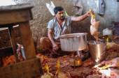 Worker boiling chicken — Stock Photo