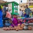 Indian woman selling pots — Stock Photo #72504751