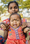Indian baby being held by family member — Stock Photo