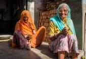 Two elderly women sit — Photo