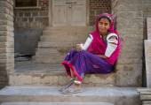 Indian tribeswoman sits — Stock Photo