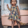 Indian child stands inside a shop — Stock Photo #78466392